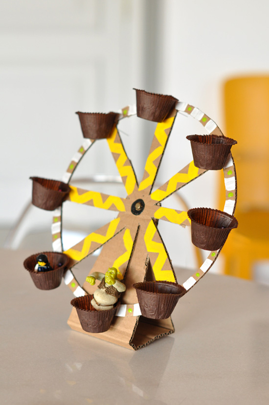 diy ferris wheel toy made out of recycled material green